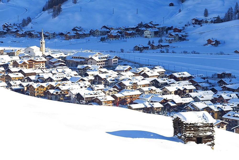 Village illuminated by sun after a snowfall, Livigno, Valtellina, Lombardy, Italy, Europe - 1269-463