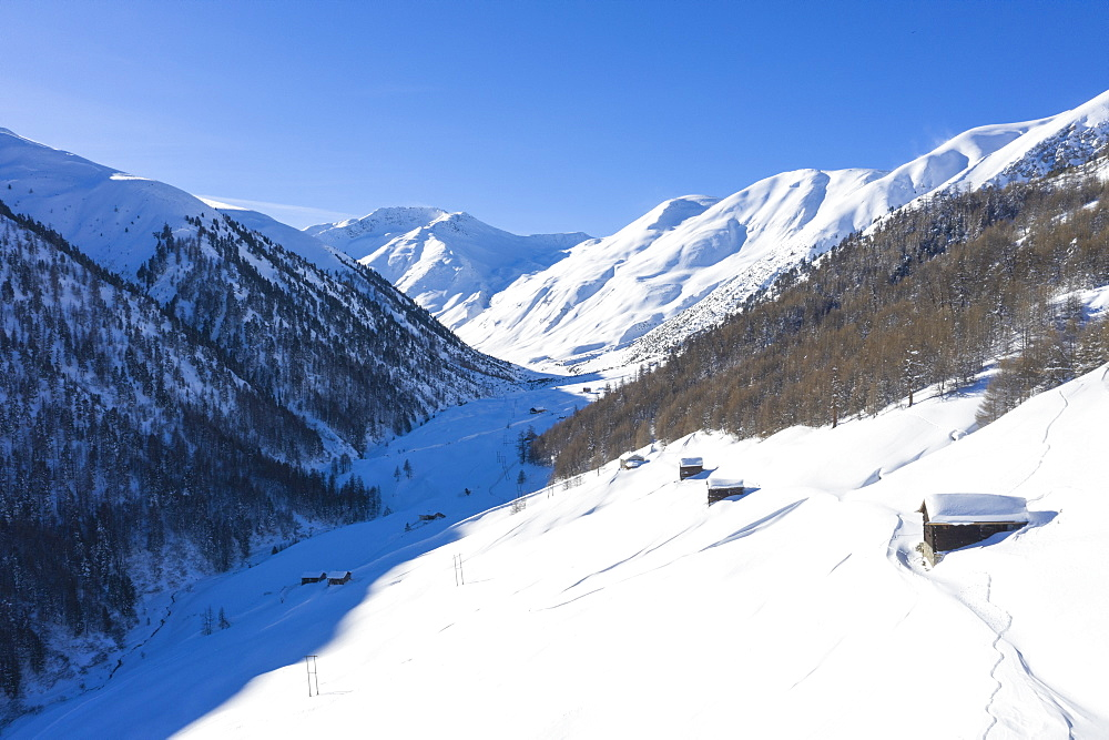 Aerial view of traditional huts in winter, Val Federia, Livigno, Valtellina, Lombardy, Italy, Europe