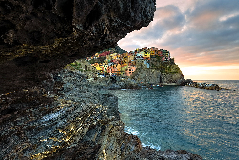 Sunrise on the village of Manarola from a sea cave, Cinque Terre, UNESCO World Heritage Site, Liguria, Italy, Europe - 1269-500