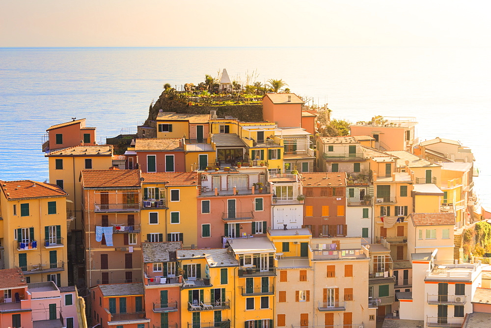 Sunlight behind the houses of Manarola, Cinque Terre, UNESCO World Heritage Site, Liguria, Italy, Europe