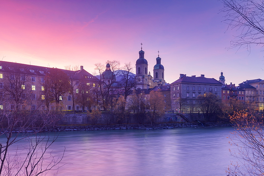 Cathedral of St James is reflected in Inn River at sunrise. Innsbruck, Tyrol, Austria, Europe.