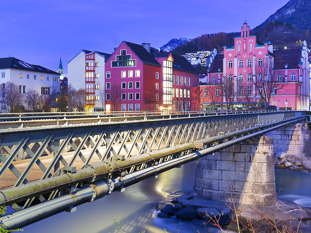 Pedestrian bridge cross the Inn river during twilight. Innsbruck, Tyrol, Austria, Europe.