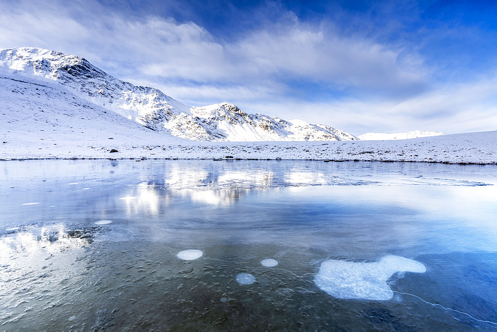Ice bubbles on the icy surface of an alpine lake, Stelvio Pass, Valtellina, Lombardy, Italy, Europe - 1269-643