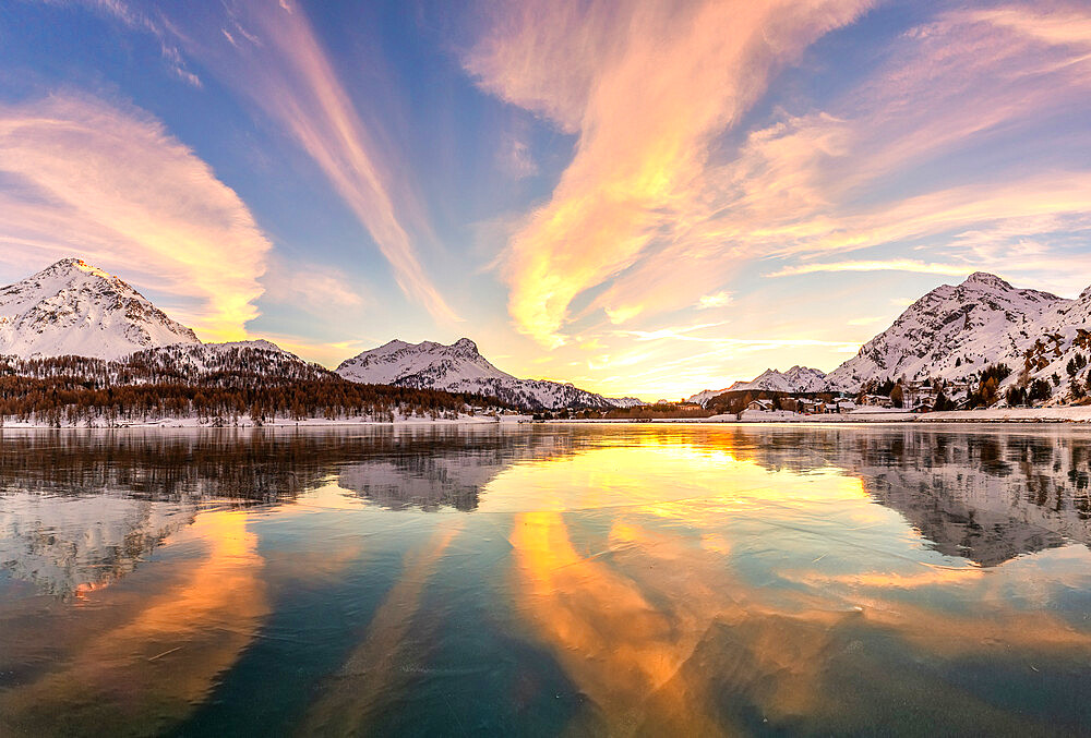 Colors of sunset reflected on the icy surface of Lake Sils, Engadine Valley, Graubunden, Switzerland, Europe - 1269-671