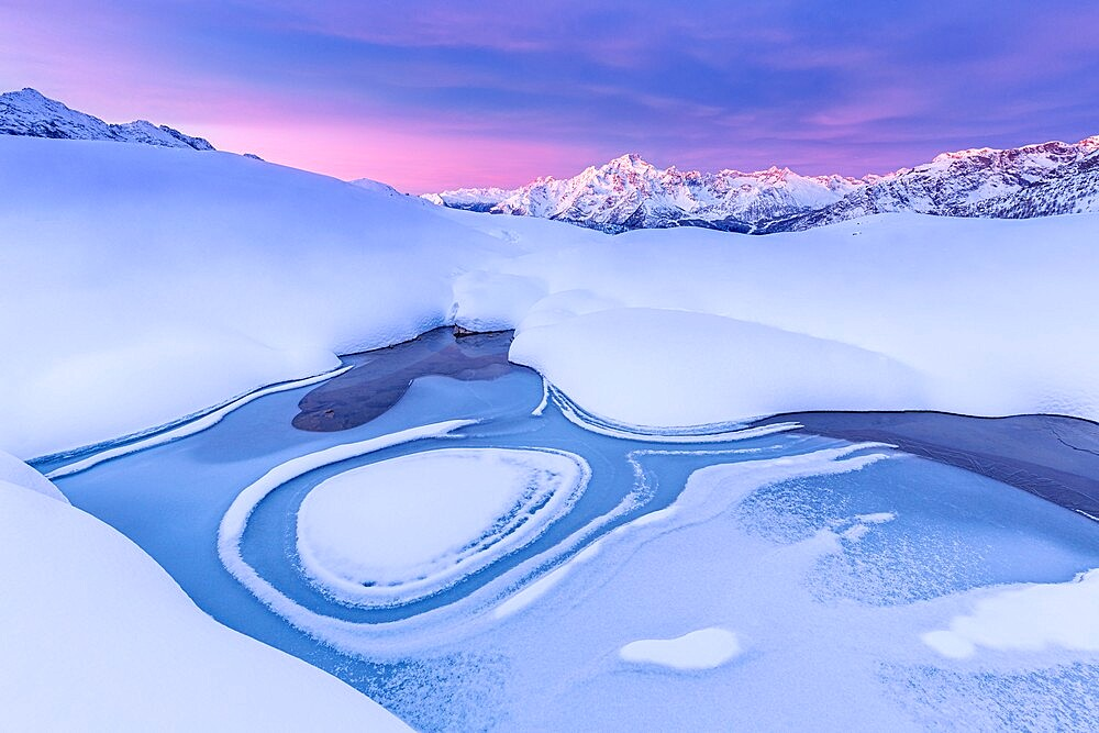 Crazy shape in a frozen alpine lake at sunrise with view of Mount Disgrazia, Valmalenco, Valtellina, Lombardy, Italy, Europe - 1269-683