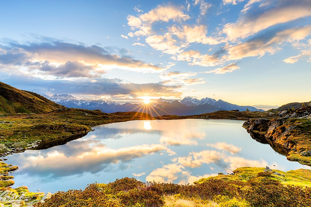 The sun and clouds reflected in the Arcoglio Lake at sunrise, Valmalenco, Valtellina, Lombardy, Italy, Europe - 1269-689