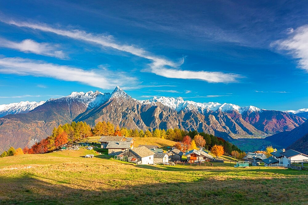 Amazing clouds above a traditional mountain village, Valchiavenna, Lombardy, Italy, Europe