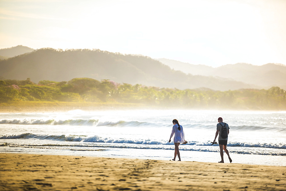 Couple on Playa Buena Vista Beach at sunrise, Guanacaste Province, Costa Rica
