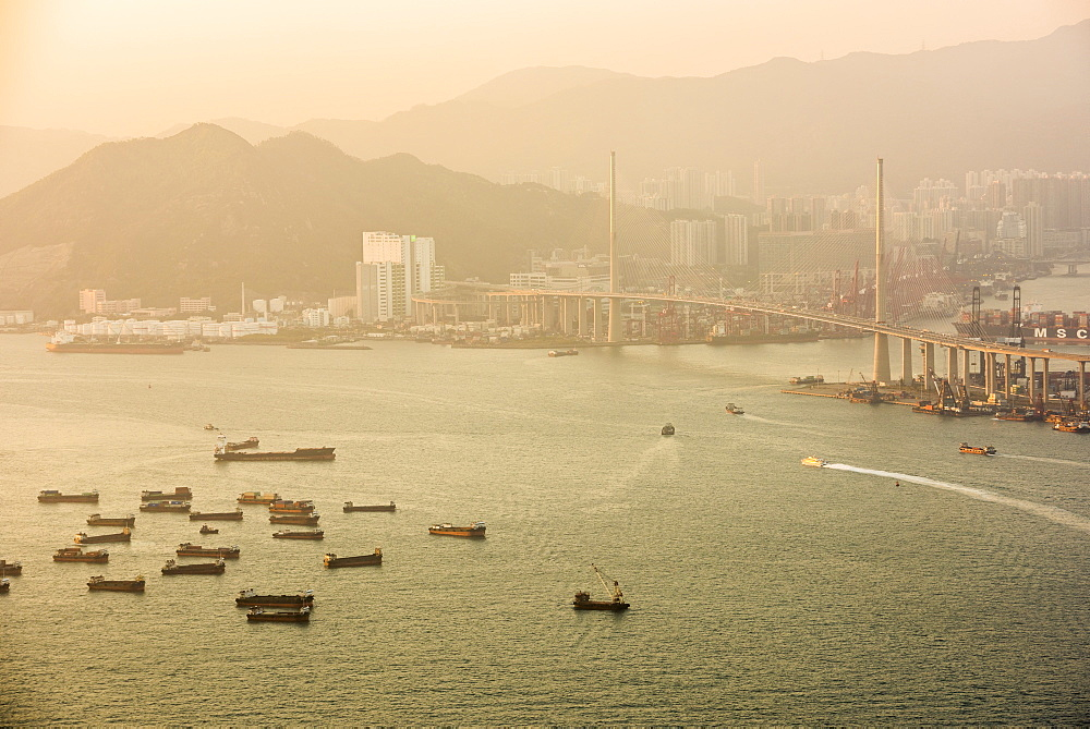 Boats in Victoria Harbour at sunset, seen from Victoria Peak, Hong Kong Island, Hong Kong, China, Asia - 1272-284