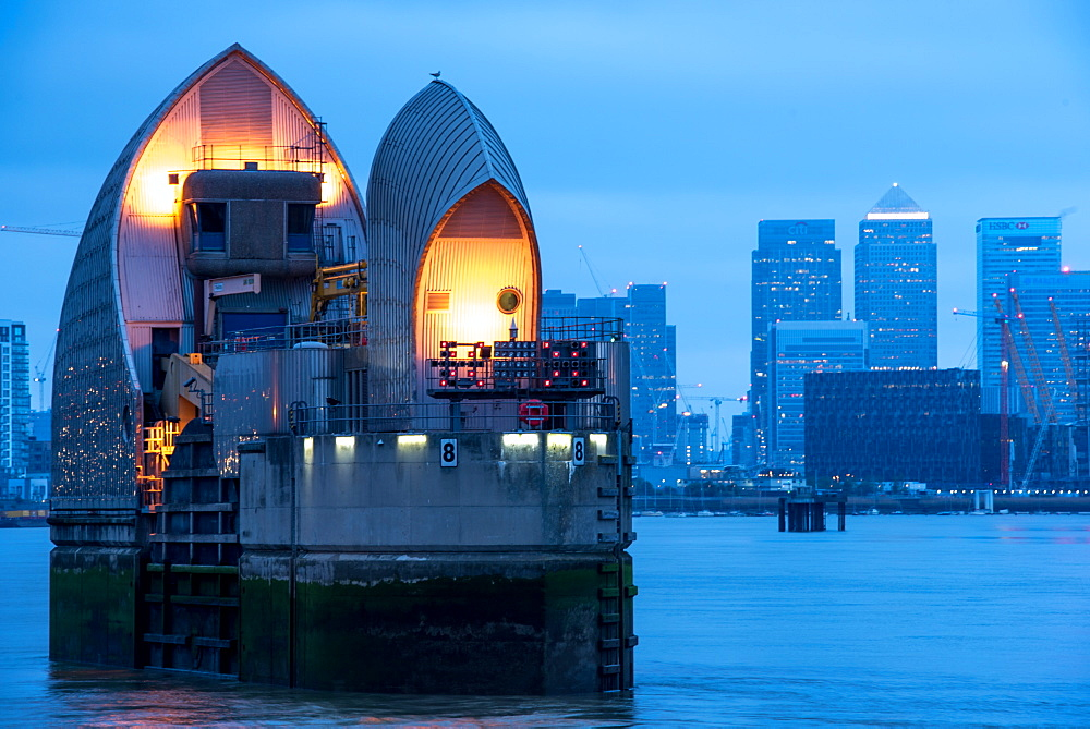 Thames Barrier and Canary Wharf at dusk, London, England, United Kingdom, Europe