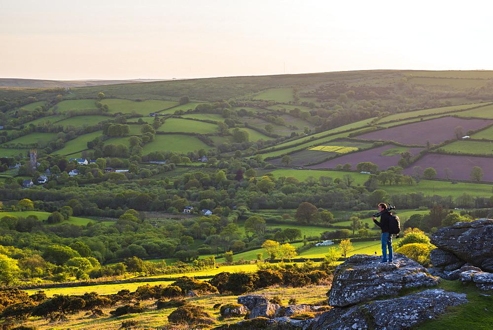 Photographer on a Tor in Dartmoor National Park, Devon, England, United Kingdom, Europe - 1272-64