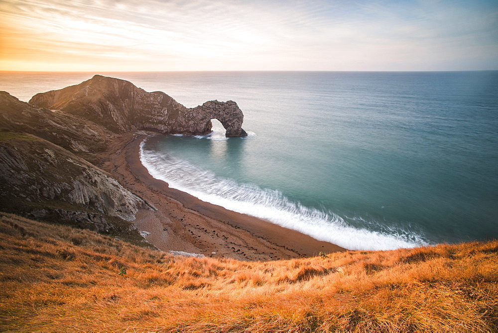 Durdle Door at sunrise, Lulworth Cove, Jurassic Coast, UNESCO World Heritage Site, Dorset, England, United Kingdom, Europe