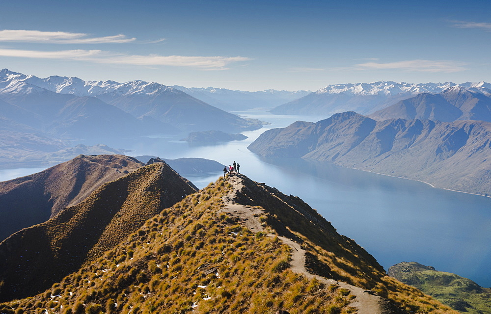 Hikers enjoying the view from the Roys Peak hiking trail near Wanaka, Otago, South Island, New Zealand, Pacific