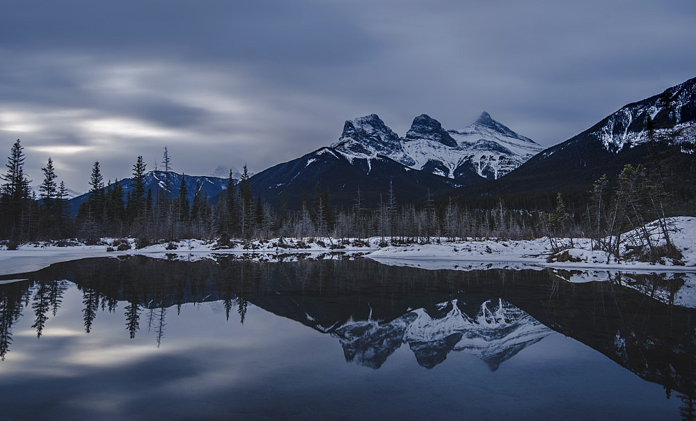 Canadian Rockies on a gloomy day, showing The Three Sisters over lake reflection, Alberta, Canada, North America - 1275-112