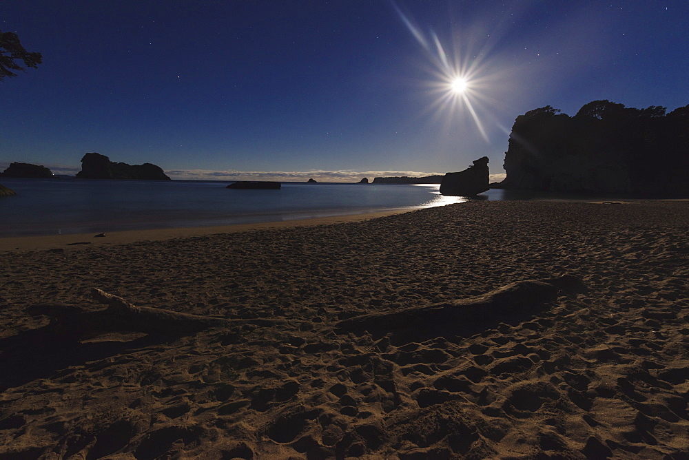 Moonlight on the beach, the Cathedral Cove (Te Whanganui-A-Hei Marine Reserve), Coromandel Peninsula., New Zealand North Island
