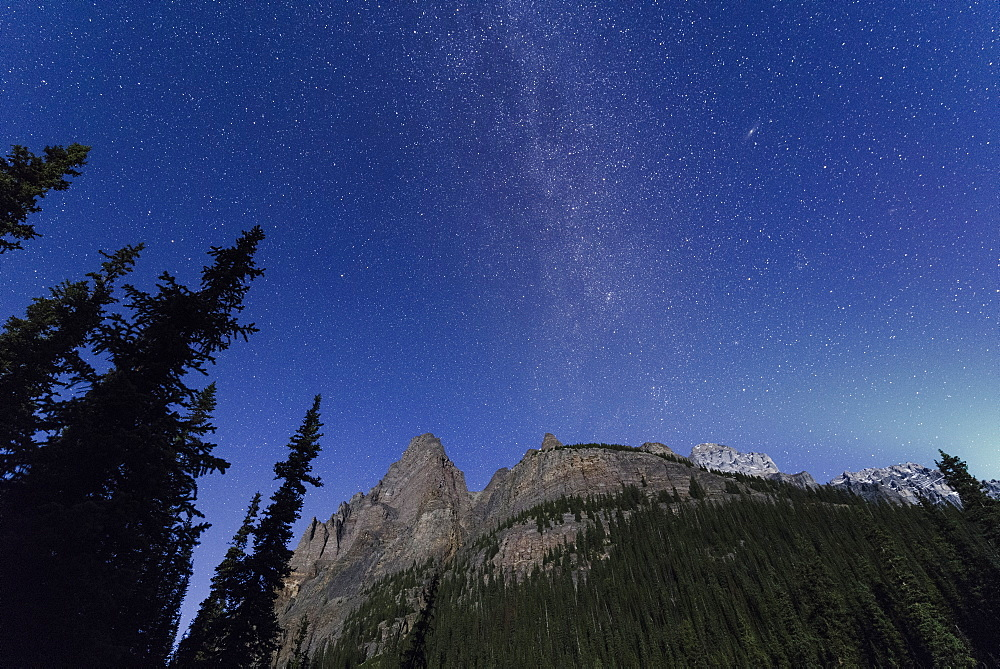 Milky way rises over the Canadian Rockies in the Yoho National Park, with moonlight cast on the mountain and Aurora over horizon, UNESCO World Heritage Site, Canadian Rockies, Alberta, Canada, North America