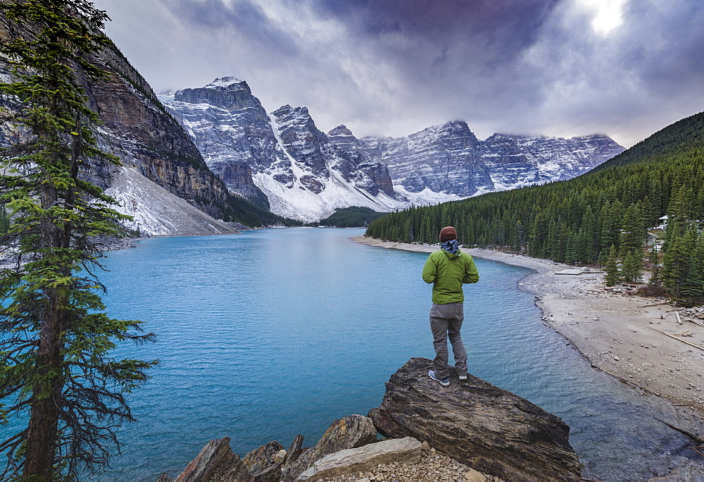 tourist watching the scenery of the Moraine Lake, Banff National Park, Alberta, Canada