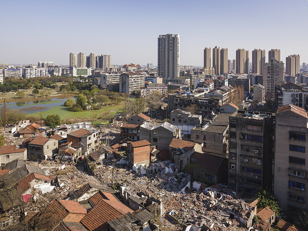 Tall buildings rise behind torn down old apartment buildings, Jingzhou, Hubei, China, Asia - 1275-67