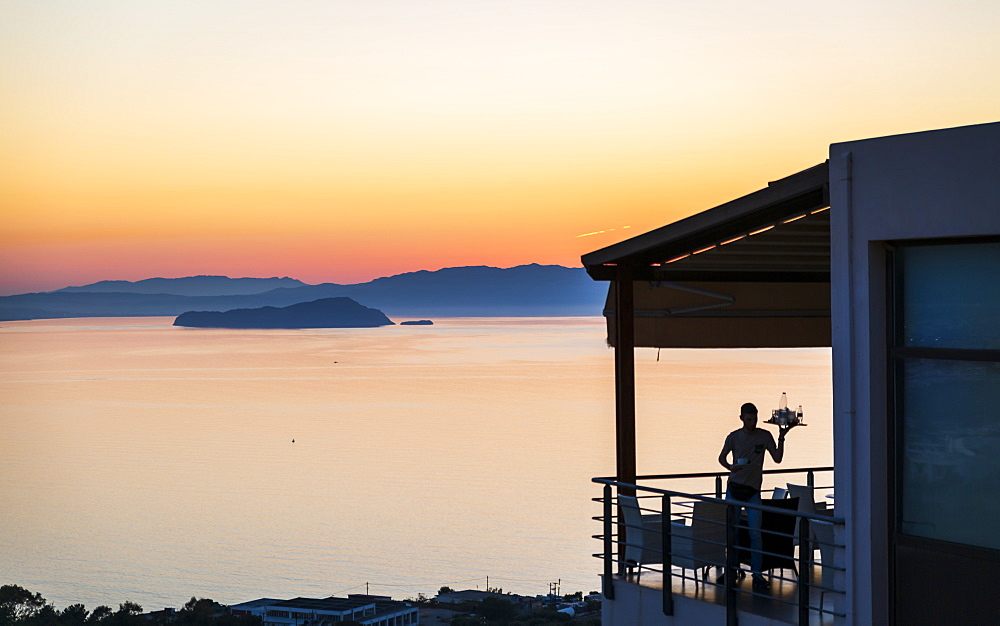 Gloomy sunset and waiter, Akrotiri, Crete, Greek Islands, Greece, Europe