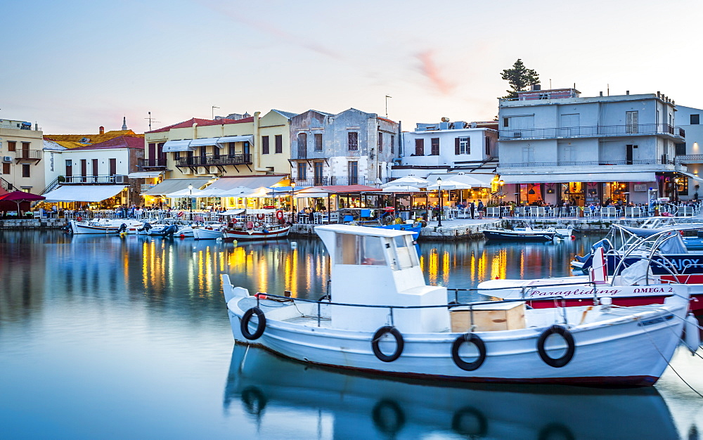 Old Venetian harbour, taverns on seaside at dusk, Rethymno (Rethymnon), Crete, Greek Islands, Greece, Europe