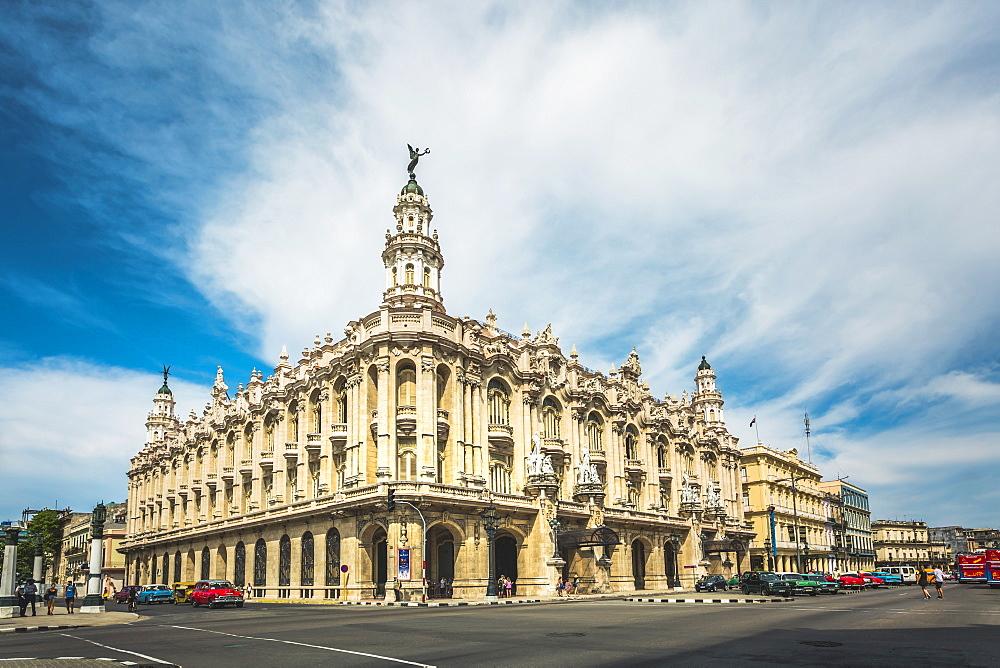 Old American cars drive past the Gran Teatro de La Habana in Havana, Cuba, West Indies, Caribbean, Central America