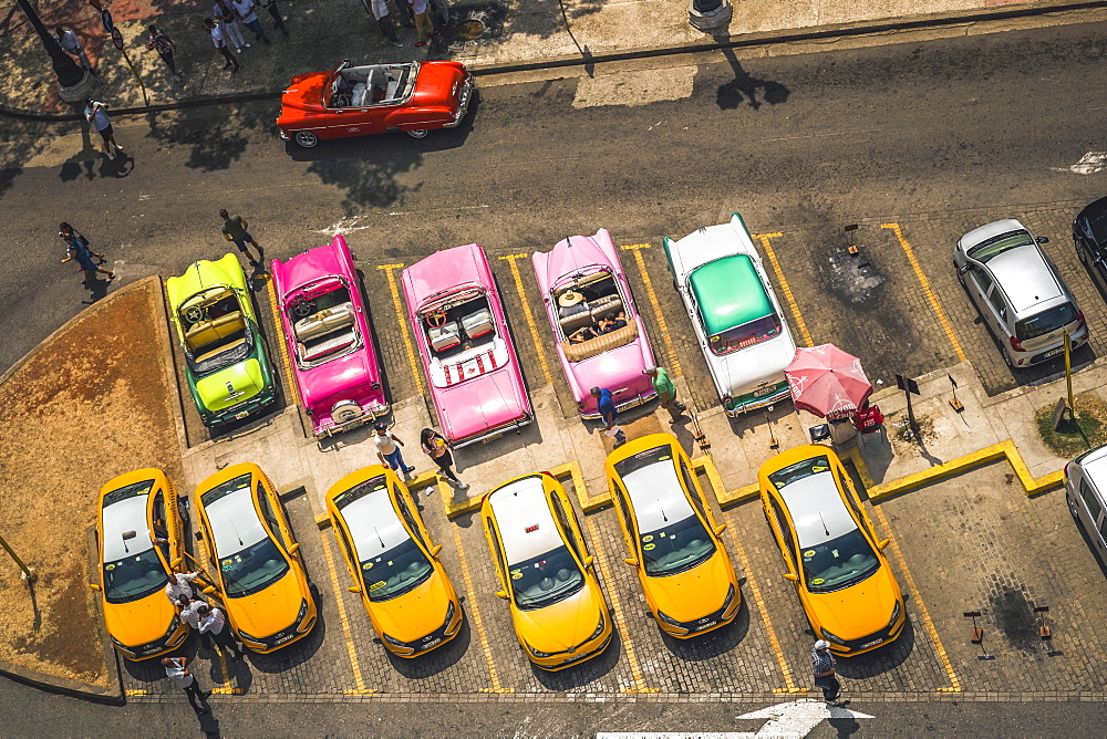 Aerial view of colourful old American taxi cars parked in Havana, La Habana, Cuba, West Indies, Caribbean, Central America