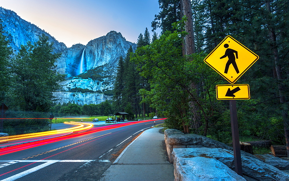 Yosemite Falls and car trail lights, Yosemite National Park, UNESCO World Heritage Site, California, United States of America,