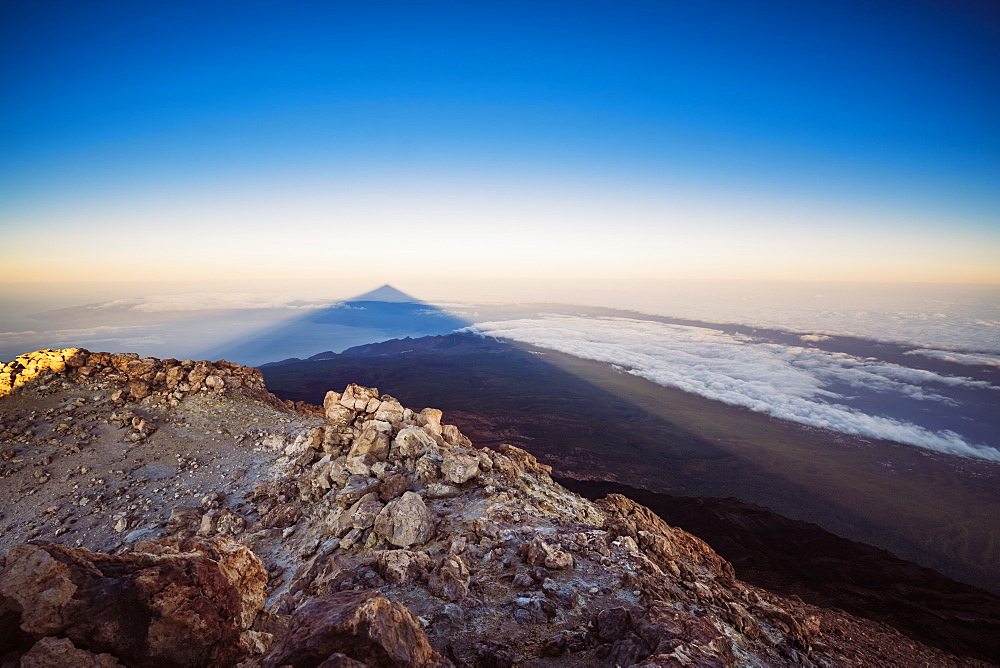 View of El Teide Volcano shadow from the summit at sunrise, El Teide National Park, UNESCO World Heritage Site, Tenerife, Canary Islands, Spain, Atlantic, Europe