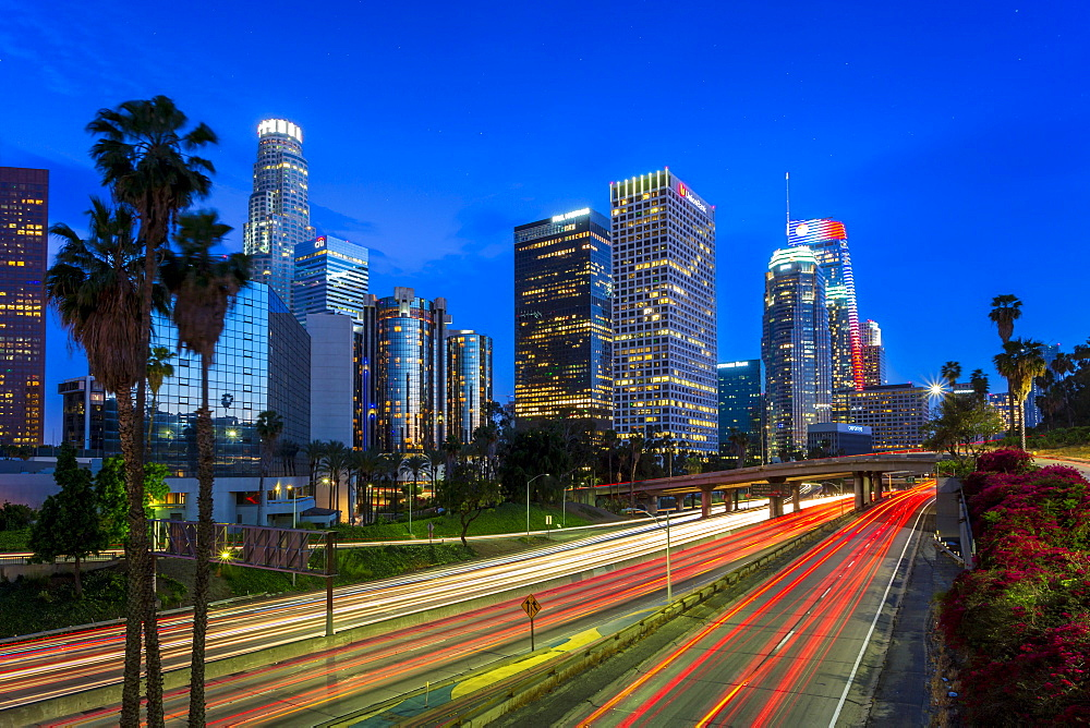 Downtown financial district of Los Angeles city and busy freeway at night, Los Angeles, California, United States of America, North America