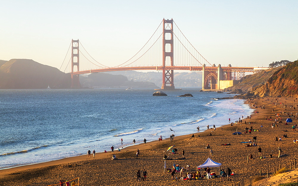 Sun sets near the Golden Gate Bridge, Baker Beach, San Francisco, California, United States of America, North America
