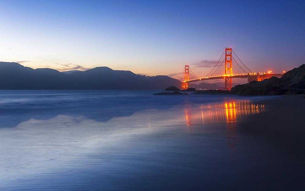 Soft flowing water reflects the beautiful Golden Gate Bridgefrom Baker beach, San Francisco, California, USA, North America - 1276-410