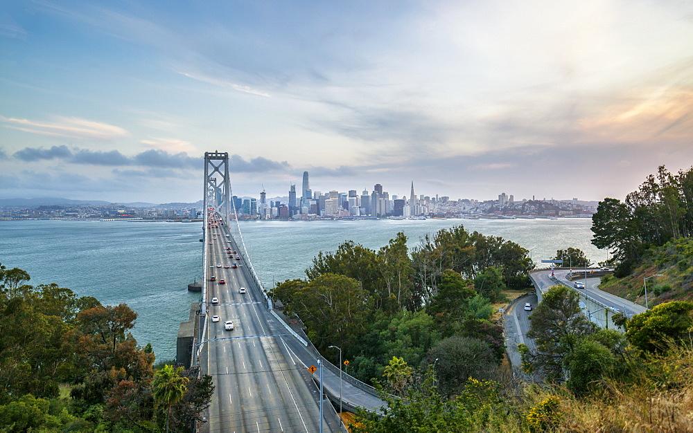 View of San Francisco skyline and Oakland Bay Bridge from Treasure Island at sunset, San Francisco, California, United States of America, North America