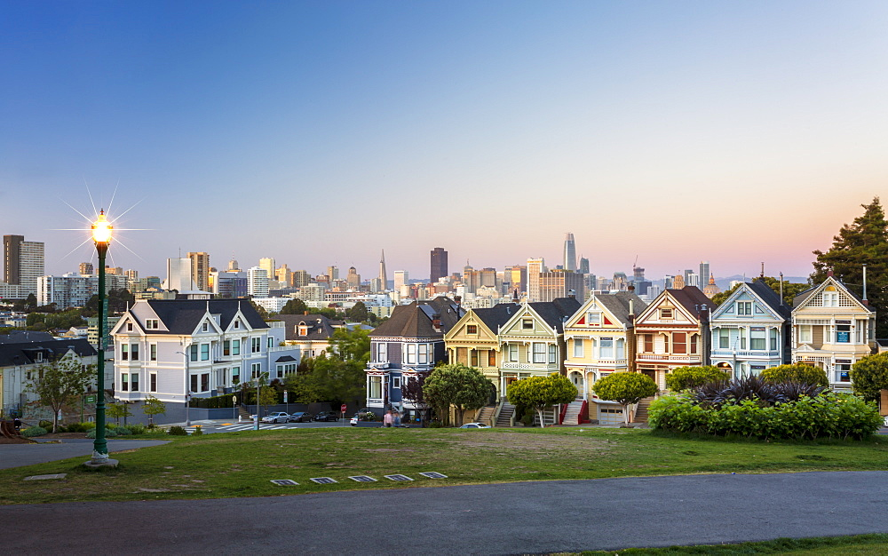 View of Painted Ladies at dusk, Victorian wooden houses, Alamo Square, San Francisco, California, United States of America, USA
