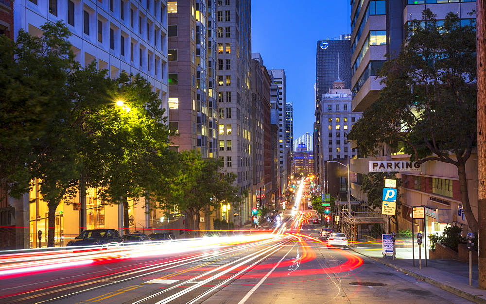 Car trail lights on Bush Street, Oakland Bay Bridge in the background, San Francisco, California, United States of America, North America