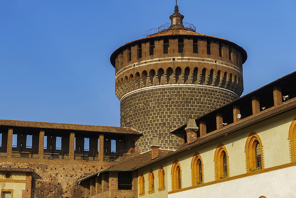 Milan, Italy Sforza Castle medieval tower. Day view of 15th century Castello Sforzesco fortified round tower.