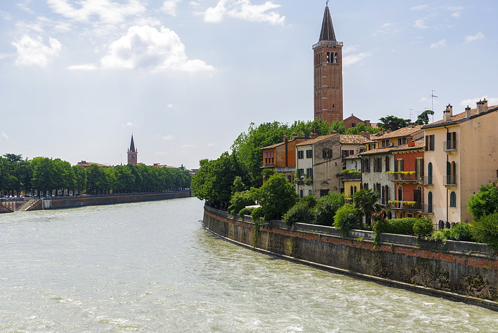 Verona, Italy river view with buildings. Traditional houses on river Adige right bank with background church bell tower view