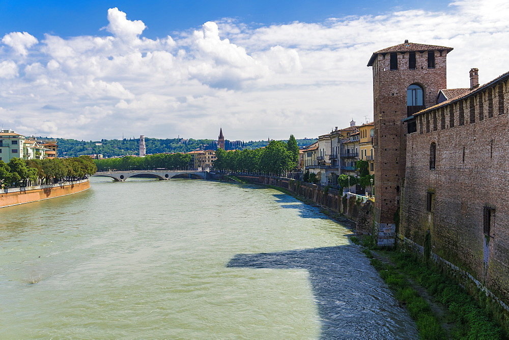 Verona, Italy river view with bridge and Castelvecchio castle. Middle Ages red bricks castle on the right bank of river Adige.