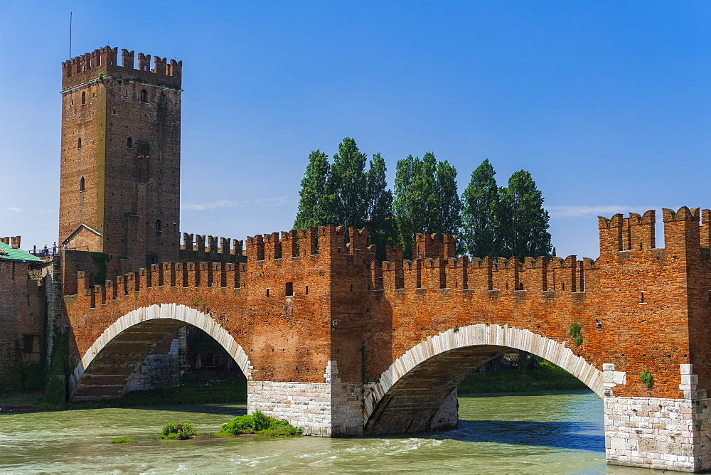 Verona, Italy Ponte Castelvecchio day view. Castelvecchio brick and marble bridge with arches on the river Adige.
