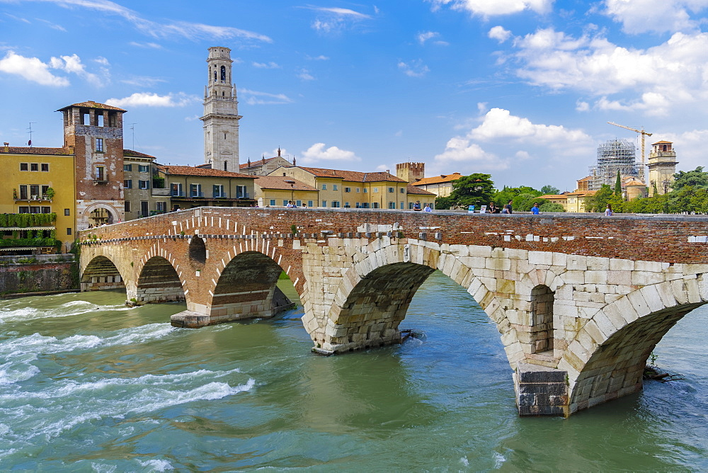 Verona, Italy Ponte Pietra day view. Pietra stone Roman arch bridge crossing river Adige.