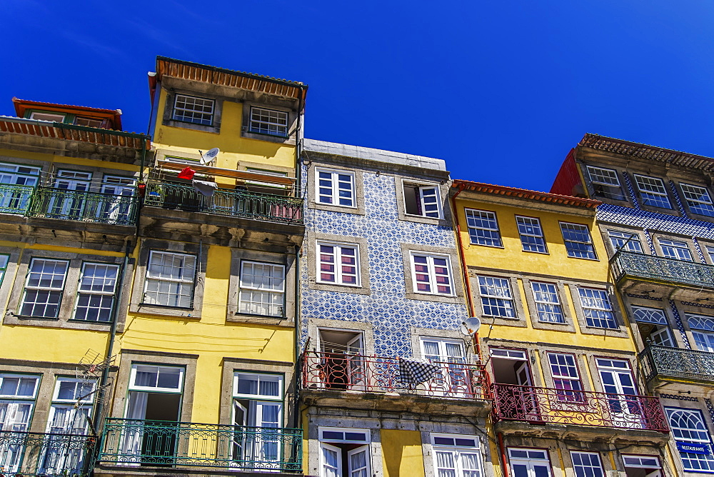 Porto, Portugal Ribeira traditional houses. Day view of traditional buildings with balconies and Portuguese Azulejo tiles.