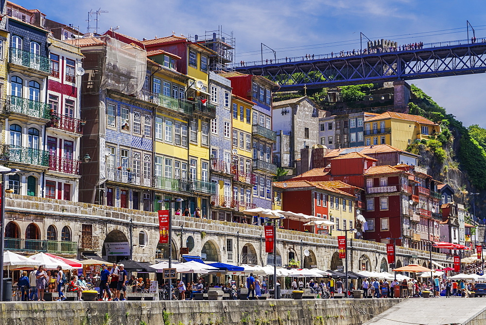 Traditional colourful buildings with balconies and umbrellas on the bank of Douro River in the Ribeira District, Porto, Portugal, Europe