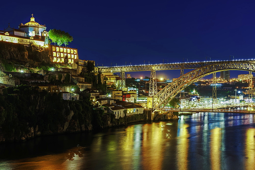 View of Monastery of Saint Augustine of Serra do Pilar and Dom Luis Bridge over the Douro River at night, Porto, Portugal, Europe