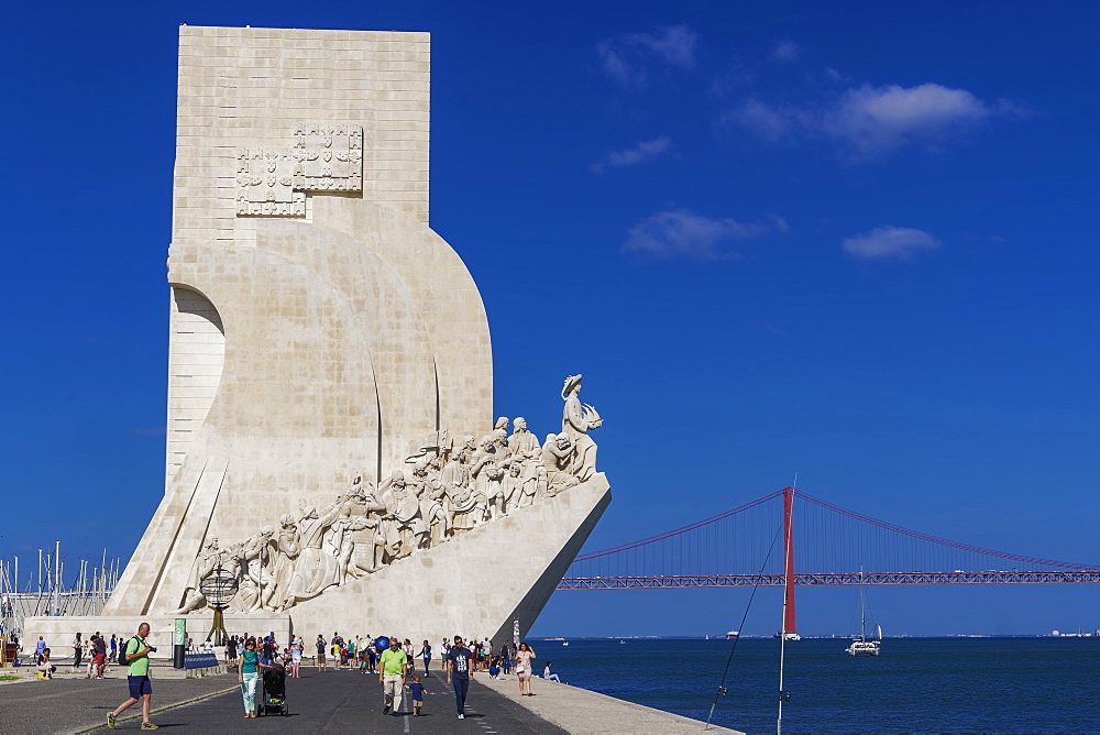 Tourists at the caravel shaped Padrao dos Descobrimentos (Monument to the Discoveries) in front of the 25 de Abril Bridge, Belem, Lisbon, Portugal, Europe