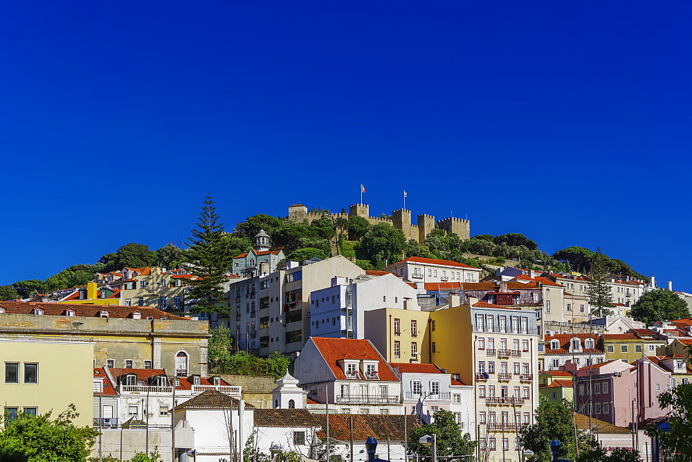 External view of The Castelo de Sao Jorge (St. George Castle) battlements, seen from city centre, Lisbon, Portugal, Europe