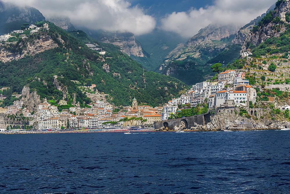 Amalfi Town, landscape sea view with low rise buildings and cliffs along the coastline in Costiera Amalfitana, UNESCO World Heritage Site, Campania, Italy, Europe