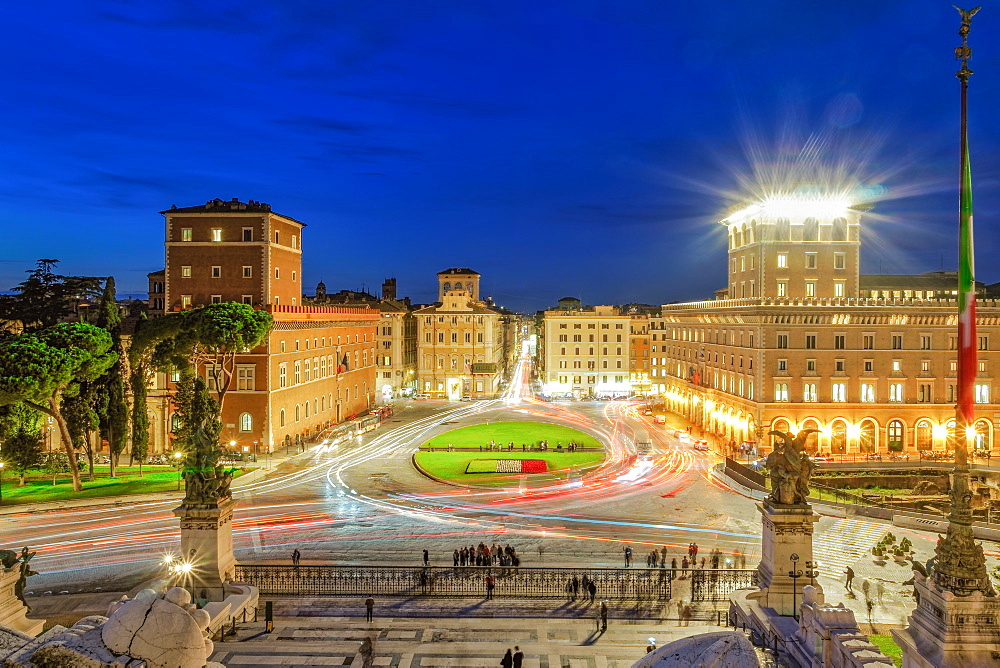 Rome, Italy Piazza Venezia Venice Square with traffic blue hour elevated view from Altare della Patria Altar of the Fatherland.