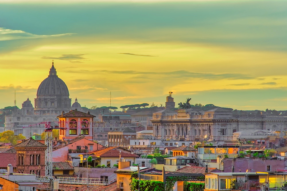 Rome rooftops landscape panorama with traditional low-rise buildings & Saint Peter???s Basilica dome golden hour elevated view.