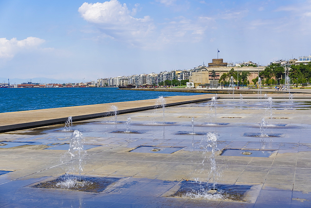 Waterfront view of fountains at umbrellas area, statue of Alexander The Great and city's landmark White Tower, Thessaloniki, Greece, Europe - 1278-31