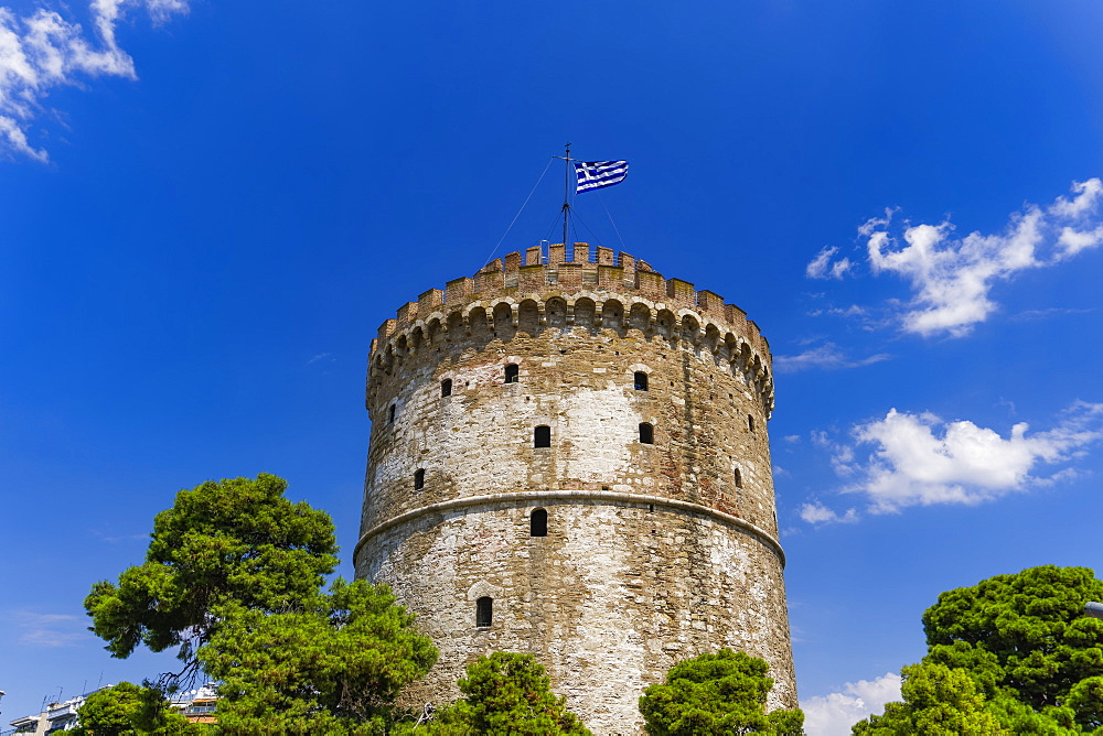 View of the city's landmark The White Tower, with Greek flag waving on top, Thessaloniki, Greece, Europe - 1278-34