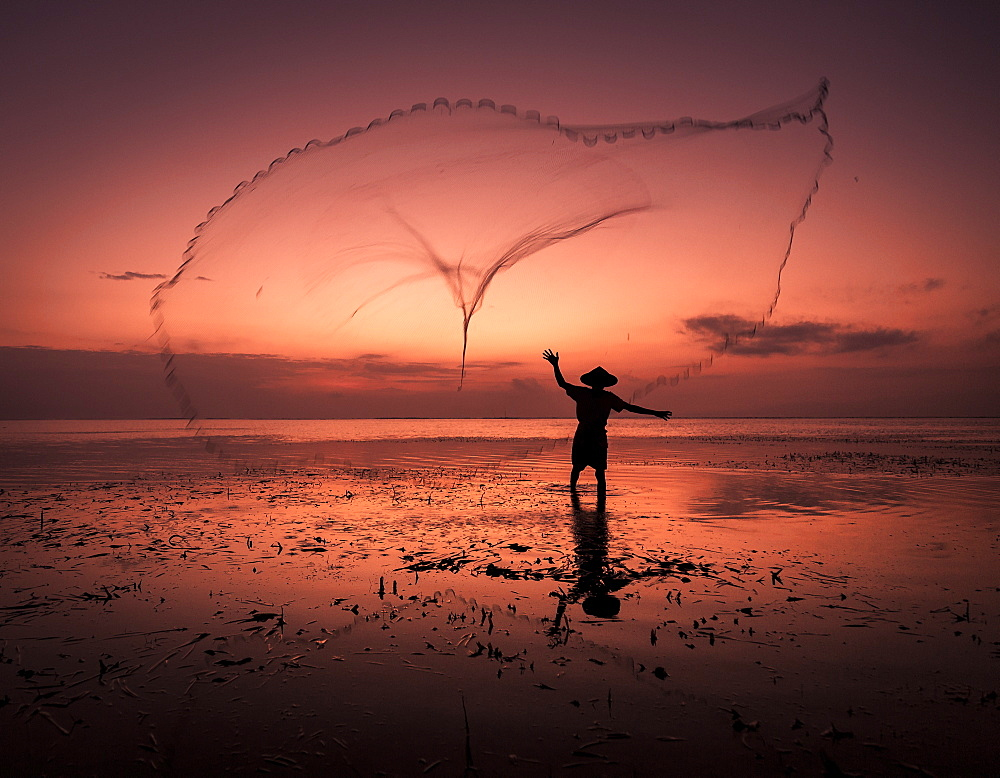 Sunrise fisherman casting his net, Bali, Indonesia, Southeast Asia, Asia - 1282-2